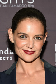 Katie Holmes added a bold pop of color with a swipe of red lipstick.