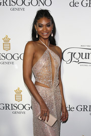 At the de Grisogono party, Chanel Iman kept the focus on her daring dress by pairing it with a simple nude leather clutch.