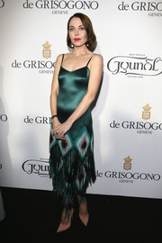 Ulyana Sergeenko was vintage-glam at the De Grisogono party in an emerald slip dress with a fringed skirt.