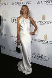 Natasha Poly donned a sultry yet classy white silk halter gown for the De Grisogono party in Cannes.
