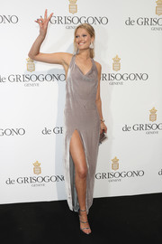 Toni Garrn chose a slinky taupe halter gown with a cowl neckline and a high slit for the De Grisogono party.