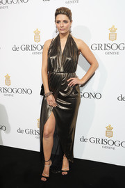 Mischa Barton channeled her inner bombshell in a slinky metallic halter gown for the De Grisogono party.