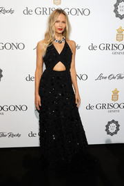 Natasha Poly was trendy-glam in a floral-sequined cutout gown by Michael Kors at the De Grisogono Love on the Rocks party.