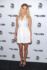 Chelsea Leyland arrived at a screening of 'The Raven' wearing a pair of black wedge sandals featuring crisp white stitching.