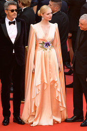 Elle Fanning brought an Old Hollywood vibe to the Cannes Film Festival opening ceremony with this caped peach gown by Gucci.