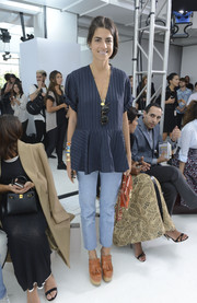 Leandra Medine attended the Delpozo fashion show looking cute in a navy V-neck peplum top.