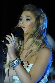 A glittery cuff bracelet added major glamour to Delta Goodrem's look during the opening of Hilton Surfers Paradise.