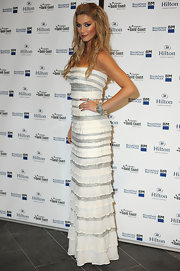 Delta Goodrem was a charmer at the opening of Hilton Surfers Paradise in a tiered white and silver strapless dress.