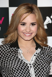 Demi's soft nude lips brightened up her whole look while at a promotion event in London.