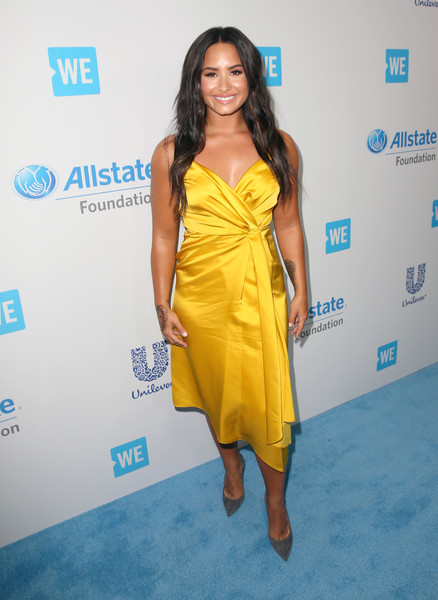 Demi Lovato Wrap Dress [clothing,dress,yellow,cocktail dress,shoulder,hairstyle,fashion,fashion model,long hair,carpet,celebs,demi lovato,young people changing the world,people,singer,california,world,inglewood,the forum,we day]