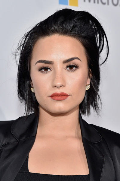 Demi Lovato Gold Studs [hair,face,eyebrow,hairstyle,lip,chin,black hair,shoulder,beauty,forehead,we carpet,demi lovato,philanthropist,songwriter,california,inglewood,the forum,we day]