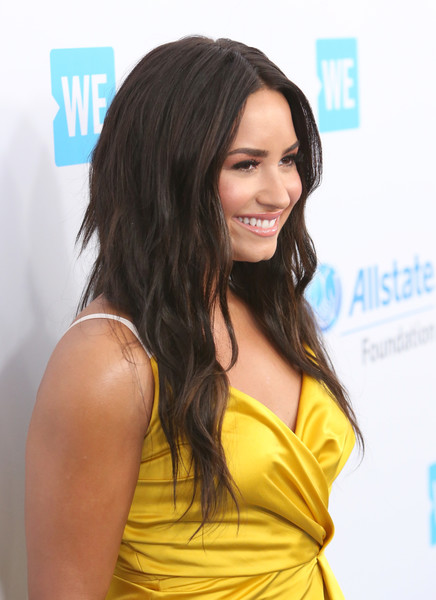 Demi Lovato Layered Cut [hair,hairstyle,long hair,beauty,layered hair,shoulder,yellow,chin,black hair,brown hair,celebs,demi lovato,young people changing the world,people,singer,california,world,inglewood,the forum,we day]