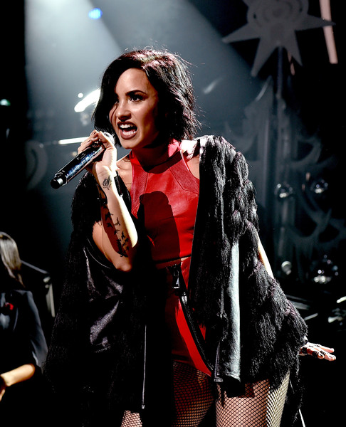 Demi Lovato Cape [performance,music artist,entertainment,performing arts,music,singing,microphone,singer,song,pop music,kiss fm,demi lovato,dallas,texas,american airlines center,capital one,jingle ball 2015 - show]