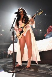 Demi Lovato looked seductive in a white Boux Avenue robe layered over a bodysuit during a performance.