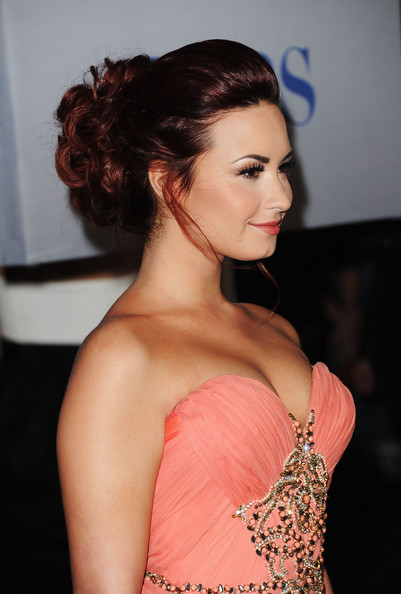Demi Lovato Bobby Pinned Updo [hair,hairstyle,shoulder,eyebrow,beauty,chin,lip,skin,lady,long hair,arrivals,demi lovato,peoples choice awards,california,los angeles,nokia theatre l.a. live]