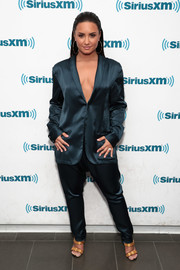 Demi Lovato sizzled in a cleavage-flaunting silk pantsuit by Baja East while visiting SiriusXM.