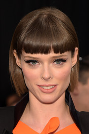 Coco Rocha worked a bob with blunt bangs at the Dennis Basso Spring 2015 show.