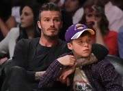 Brooklyn Beckham showed some serious team spirit, wearing a Lakers cap to watch his team win Game One of the 2012 Western Conference Quarter Finals.