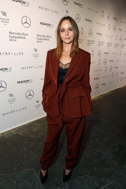 Stella McCartney sported a super-baggy rust pantsuit at the Designer for Tomorrow show.