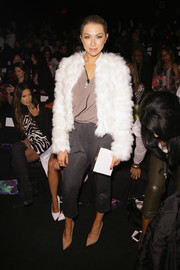 Stassi Schroeder attended the Desigual fashion show looking toasty and chic in a white fur coat.