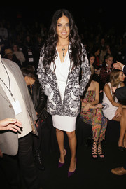 Adriana Lima injected a punch of color into her monochrome outfit with a pair of purple Christian Louboutin pumps.