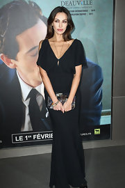 Madalina Ghenea added subtle accessories to her outfit by wearing a long pendant necklace.