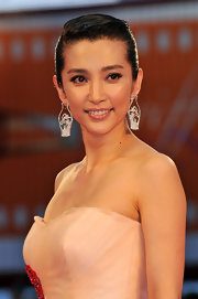 Li Bingbing showed off her sparkling diamond earrings while hitting the Venice Film Festival.