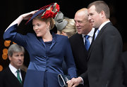 Autumn Phillips wore a blue flat statement hat that was accented with large red and white flowers to attend Thanksgiving service.
