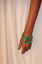 Sonam Kapoor paired her elegant dress with an emerald green bangle bracelet.