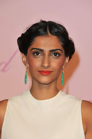 Sonam Kapoor added a little glam to her bronzed look with ripe cherry red lipstick.