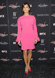 Gina Gershon brought a stylish '60s vibe to the 'Diana Vreeland: The Eye Has to Travel' premiere with this long-sleeve pink cocktail dress.