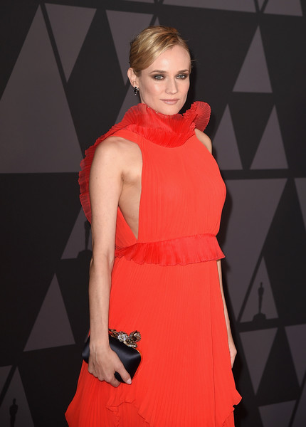 Diane Kruger Satin Clutch [clothing,fashion model,dress,cocktail dress,red,fashion,shoulder,beauty,carpet,neck,diane kruger,hollywood highland center,california,the ray dolby ballroom,academy of motion picture arts and sciences,9th annual governors awards]