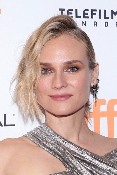 Diane Kruger Messy Updo [in the fade premiere,hair,eyebrow,blond,beauty,human hair color,hairstyle,chin,fashion model,forehead,eyelash,diane kruger,toronto,canada,the elgin,toronto international film festival,premiere,diane kruger,in the fade,2017 toronto international film festival,cannes,film,updo,actor,hairstyle,celebrity]