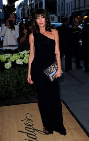 Tamara showed off her leopard printed clutch while hitting the DVF launch party in London England.
