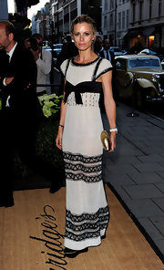 Laura dons a black and white floor length gown with lovely detail embellishments.