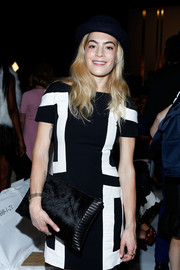 Chelsea Leyland teamed a black fur clutch with a mod dress for the Diane Von Furstenberg fashion show.