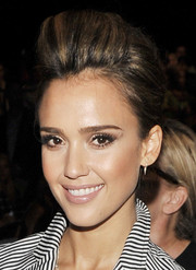 Jessica Alba rocked a sky-high pompadour at the Diane Von Furstenberg fashion show.