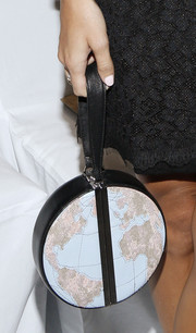 Harley Viera-Newton's globe purse added a quirky touch to her look during the Diane Von Furstenberg fashion show.