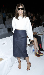 Carine Roitfeld was casual yet smart in a denim skirt and a crop top at the Diane Von Furstenberg fashion show.