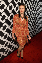 Kate Nash chose a chic leopard-print wrap dress for the Journey of a Dress exhibition opening.