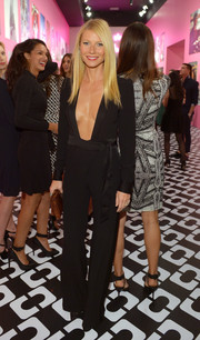 Gwyneth Paltrow brought major sexiness to the Journey of a Dress exhibition opening in a cleavage-revealing black jumpsuit by Diane von Furstenberg.