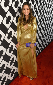 Aimee Song's blue snakeskin clutch provided a striking color contrast to her gold dress.