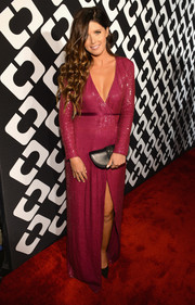 Katherine Schwarzenegger complemented her lovely dress with a crescent-shaped black leather clutch.