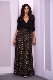 Irina Shayk oozed feminine elegance in this mixed-material wrap gown during the Diane von Furstenberg presentation.