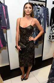 Jessica Szohr made a sultry appearance at a National Multiple Sclerosis Society event wearing a low-cut slip dress rendered in black and gold sequins.