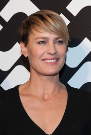 Robin Wright looked cool with her emo bangs at Diane von Furstenberg's 'Journey of a Dress' opening party.