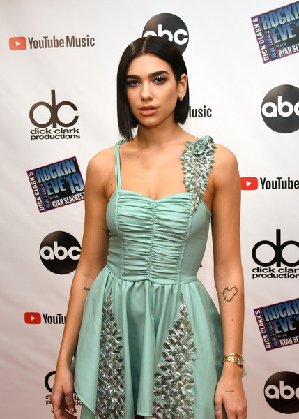 Dua Lipa attended Dick Clark's New Year's Rockin' Eve 2019 wearing an elegant gold rectangle-faced watch.