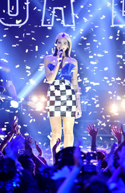 Dua Lipa looked flirty in a strapless mini dress with a pleated bodice and a checkered skirt while performing at Dick Clark's New Year's Rockin' Eve.