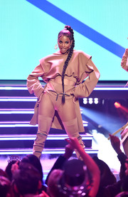 Ciara flashed her taut abs in a loose nude crop-top at Dick Clark's New Year's Rockin' Eve.