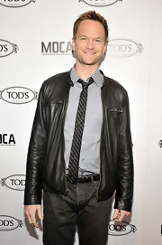 Neil Patrick Harris opted for a cool look in a leather jacket and tie.